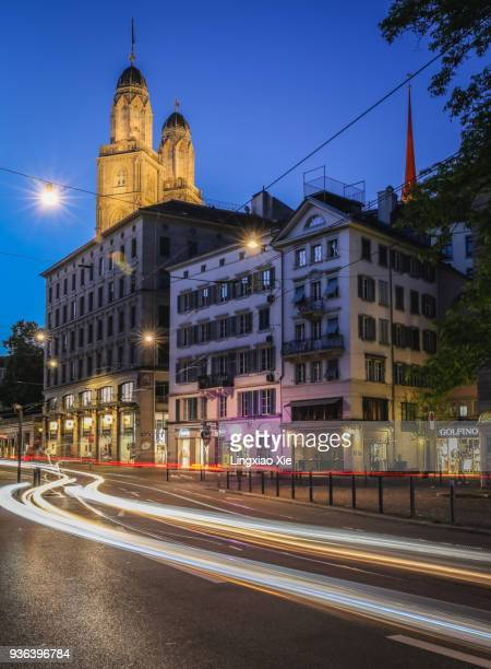 illuminated zurich old town with light trails at dusk, switzerland - vehicle light stock photos and pictures