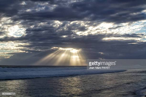 illuminating sunbeams - jean marc payet stock pictures, royalty-free photos & images