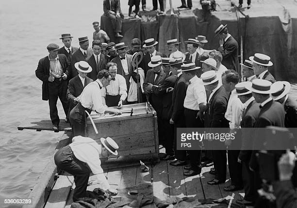 Illusionist and escape artist Harry Houdini is submerged in the East River in a crate New York City 7th July 1912 He escaped in just under a minute