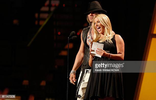 ACCESS*** Illusionist Criss Angel and actress Poppy Montgomery present the Single Record of the Year award onstage during the 43rd annual Academy Of...