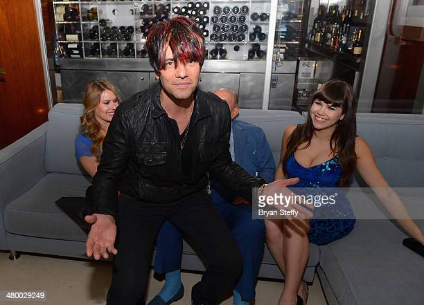 Illusionist Criss Angel and model Claire Sinclaire appear during Cirque du Soleil's 2nd annual 'One Night for One Drop' at the Mandalay Bay Resort...