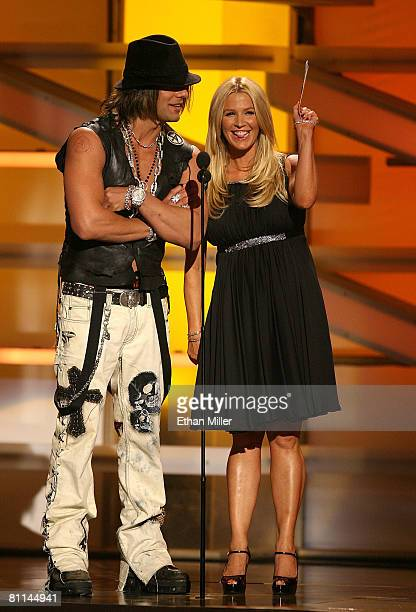 Illusionist Criss Angel and singer Poppy Montgomery onstage during the 43rd annual Academy Of Country Music Awards held at the MGM Grand Garden Arena...