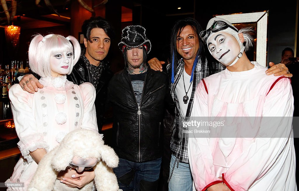 Illusionist Criss Angel, guitarist Dj Ashba of Guns N' Roses and artist Michael Godard appear with 'Zarkana by Cirque du Soleil' characters at the reception for the Las Vegas premiere of 'Zarkana by Cirque du Soleil' at the Gold Boutique Nightclub and Lounge at the Aria Resort & Casino at CityCenter on November 9, 2012 in Las Vegas, Nevada.