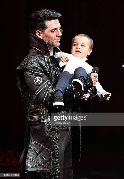 Illusionist Criss Angel holds his son Johnny Crisstopher Sarantakos during Criss Angel's HELP charity event at the Luxor Hotel and Casino benefiting...