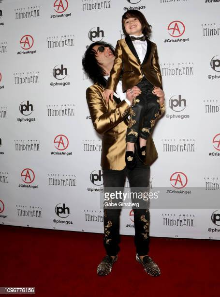 Illusionist Criss Angel lifts up his son Johnny Crisstopher Sarantakos during the grand opening of Criss Angel MINDFREAK at Planet Hollywood Resort...