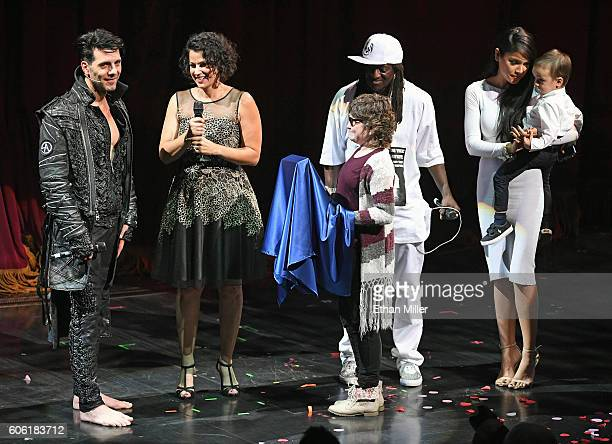 Illusionist Criss Angel MakeAWish Southern Nevada President and CEO Caroline Ciocca Kaila Elders from the MakeAWish Foundation rapper Flavor Flav...