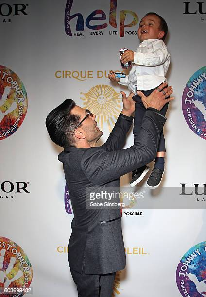 Illusionist Criss Angel plays with his son Johnny Crisstopher Sarantakos during Criss Angel's HELP charity event at the Luxor Hotel and Casino...