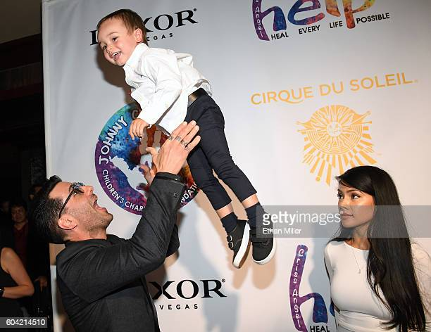 Illusionist Criss Angel tosses his son Johnny Crisstopher Sarantakos in the air as his mother Shaunyl Benson looks on at Criss Angel's HELP charity...
