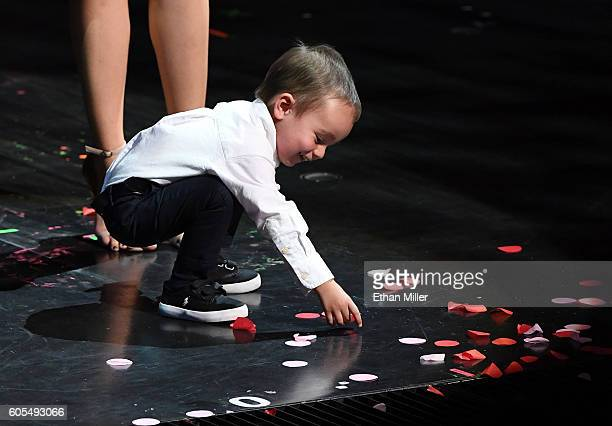 Illusionist Criss Angel's son Johnny Crisstopher Sarantakos plays with confetti on the stage during Criss Angel's HELP charity event at the Luxor...