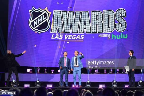 Illusionist Darcy Oake performs a card trick with Clayton Keller of the Arizona Coyotes Brock Boeser of the Vancouver Canucks and Mathew Barzal of...