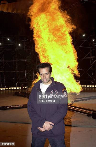 Illusionist David Copperfield stands in front of a tornado of fire 28 March 2001 at a press conference in New York Copperfield will attempt to enter...