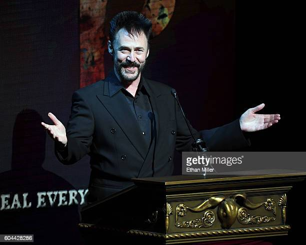 Illusionist Lance Burton speaks during Criss Angel's HELP charity event at the Luxor Hotel and Casino benefiting pediatric cancer research and...