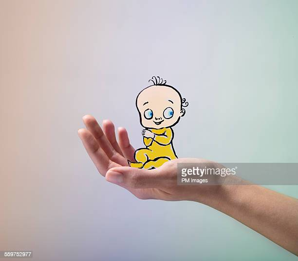 Illustrated baby in hand