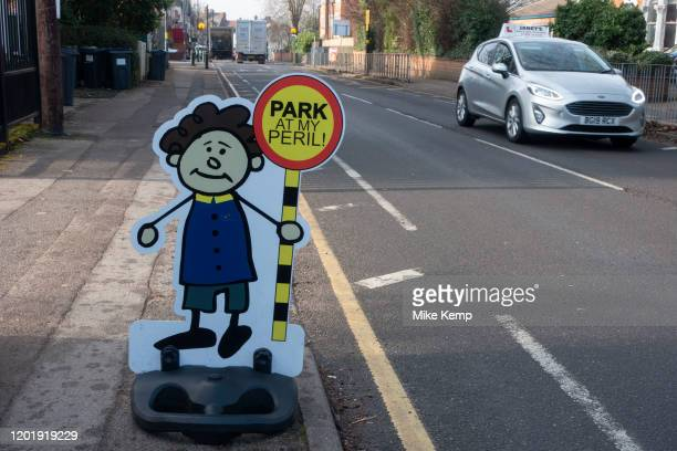 Illustrated characters of small children war motorists not to park at a nearby primary school in Kings Heath on 7th Febuary 2020 in Birmingham,...