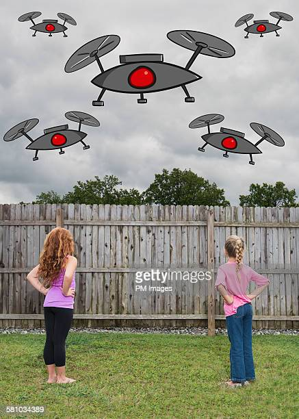 illustrated drones over back yard - mixed media stock pictures, royalty-free photos & images