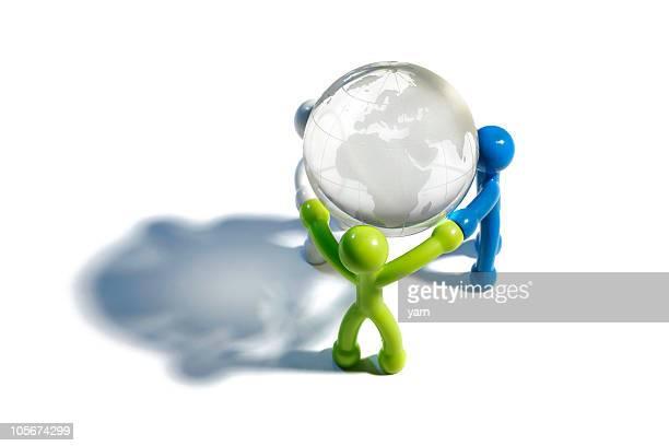 Illustrated people holding globe on white surface
