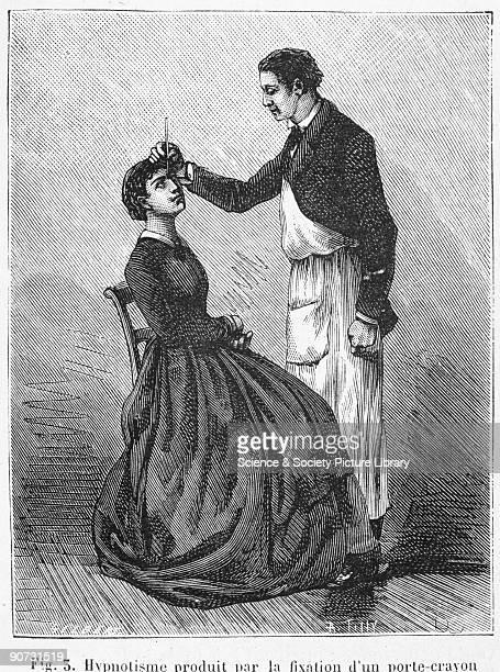Illustration by Gilbert taken from 'La Nature' edited by Gaston Tissandier captioned 'Hypnotisme produit par la fixation d'un portecrayon place entre...