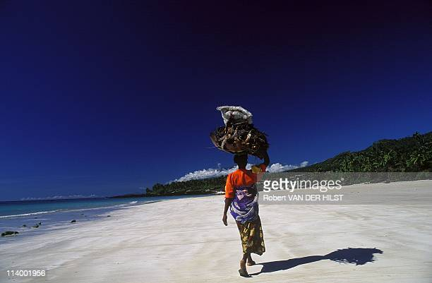 Illustration Comoros In Comoros In April 2003On Bouni Beach woman with recolt going back to her village
