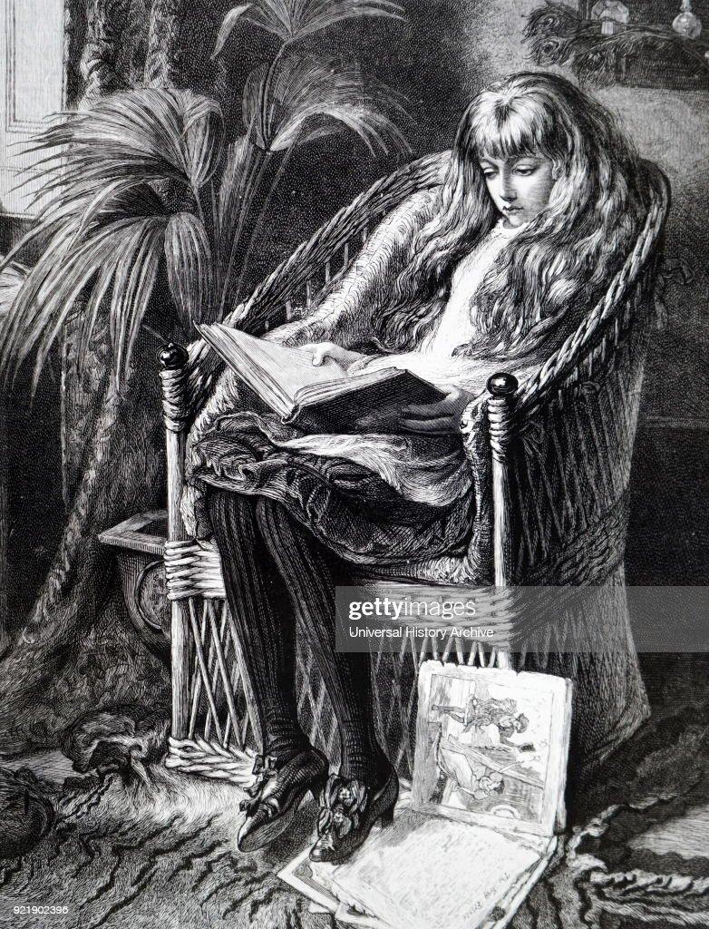 A girl reading. : News Photo