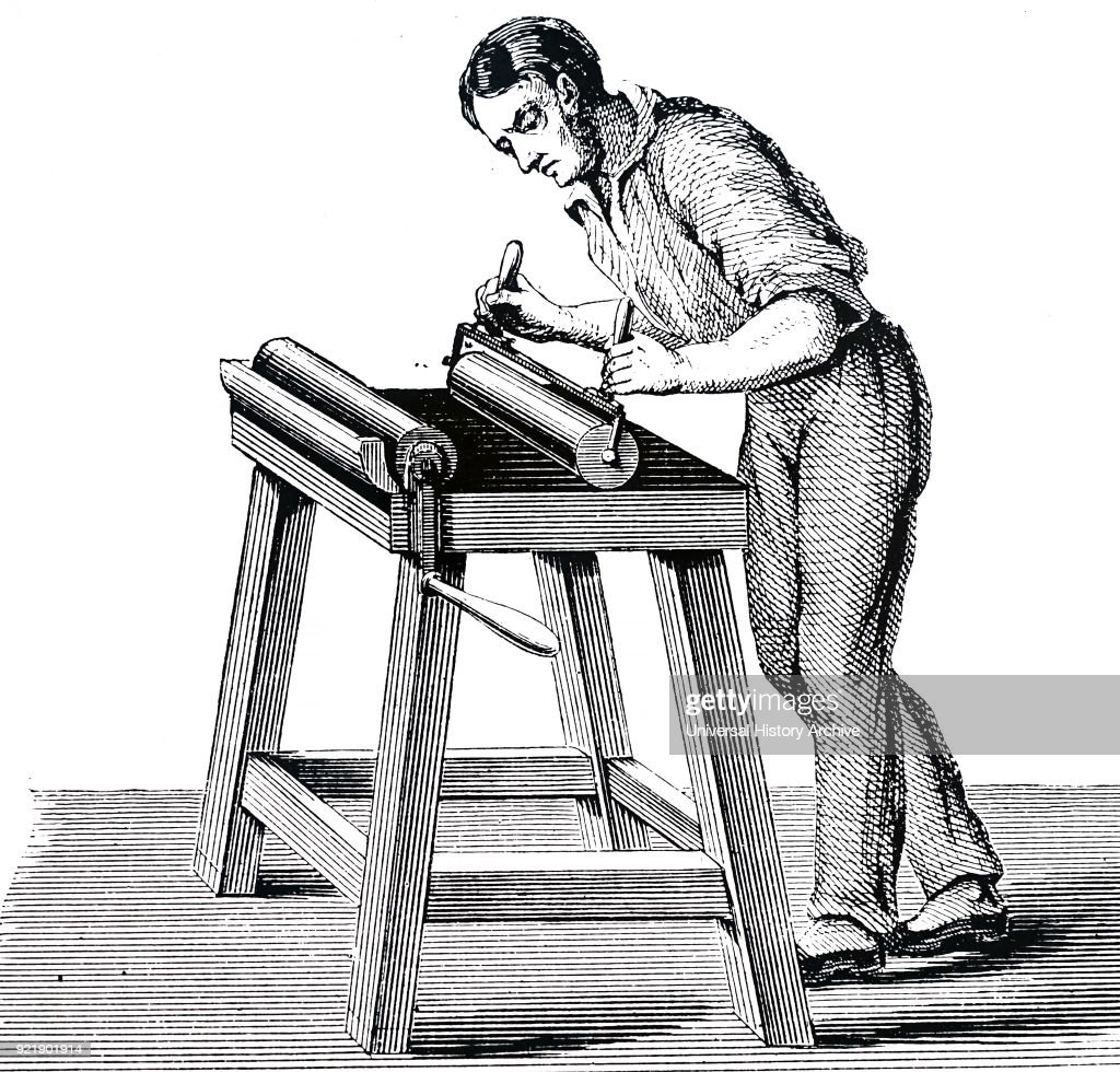 Illustration depicting an inking table for inking rollers used in printing. Dated 19th century.