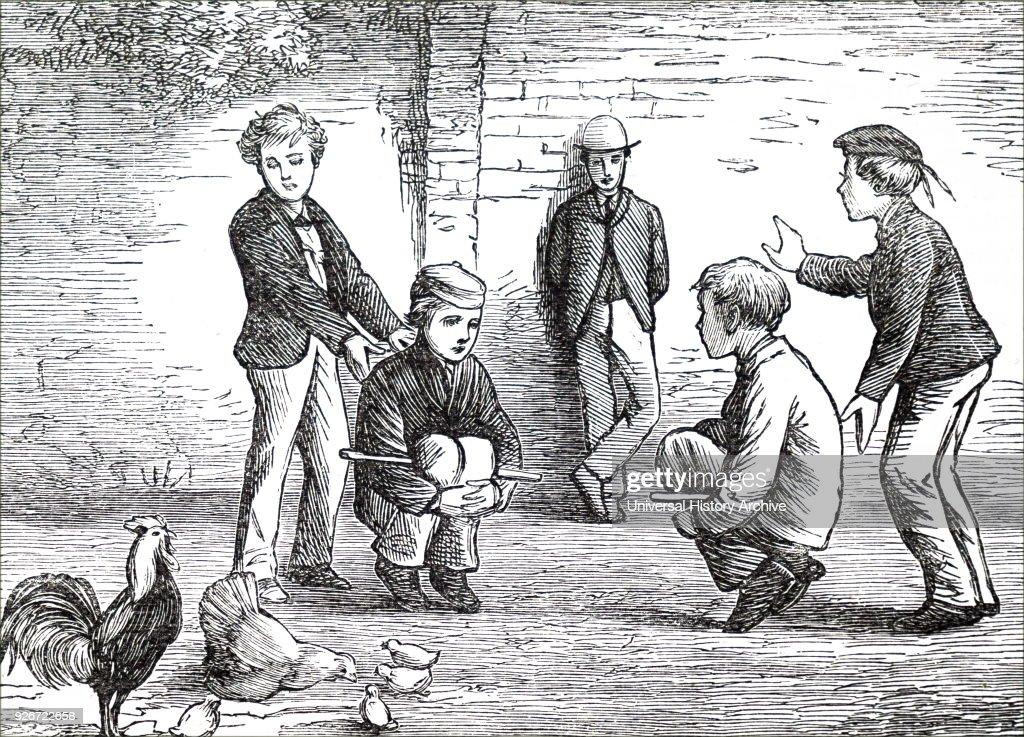 Boys playing cock-fighting. : News Photo