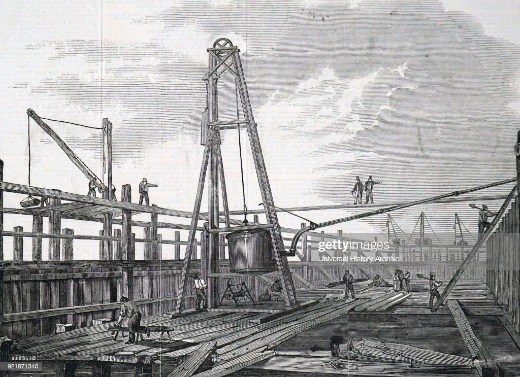 Illustration depicting Clarke & Varley's atmospheric pile driving machine. A steam engine was used to pump out the air from the cylinder, with the result that atmospheric pressure forced a piston downwards. The downward motion of the piston lifted the weight ready for dropping. Dated 19th century.
