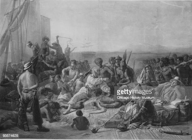 Illustration depicting slave traffic on the coast of Africa showing slave traders relaxing in the foreground while in the background men are loaded...