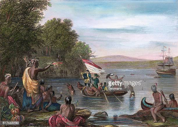 Illustration depicting the landing of Henry Hudson his boat being greeted by Native Americans at the lakeshore Undated colored engraving