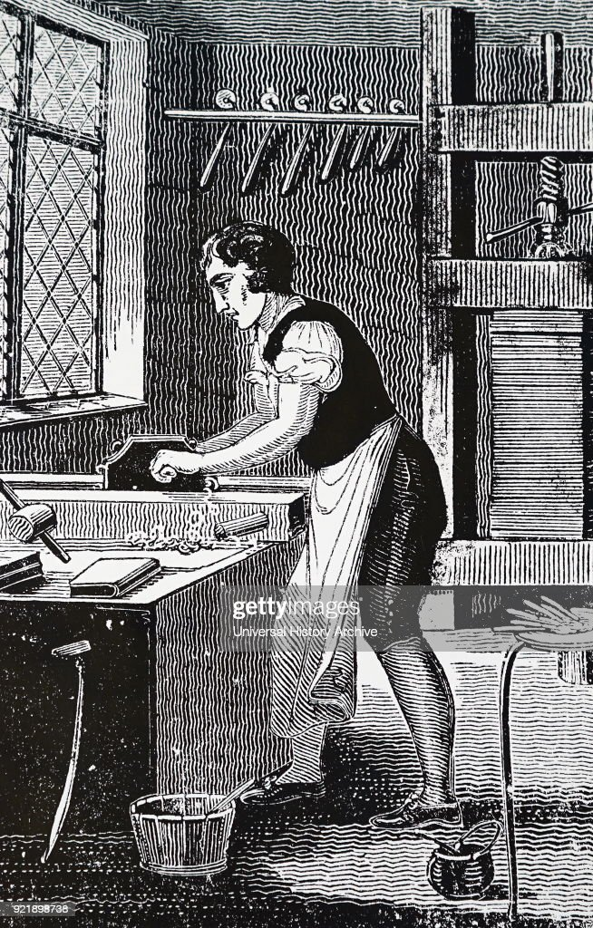 Illustration depicting the process of bookbinding: the binder is shown here ploughing the edges of a book, a process which was usually done on the more expensive volumes. Behind him a pile of books is being compressed in a standing press, and on a portable brazier in the foreground are the tools used to decorate the bindings. Dated 19th century.