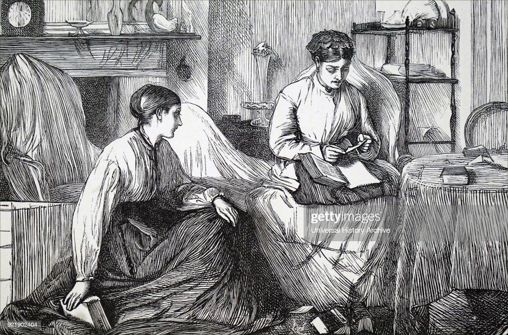 Two women looking through books. : News Photo