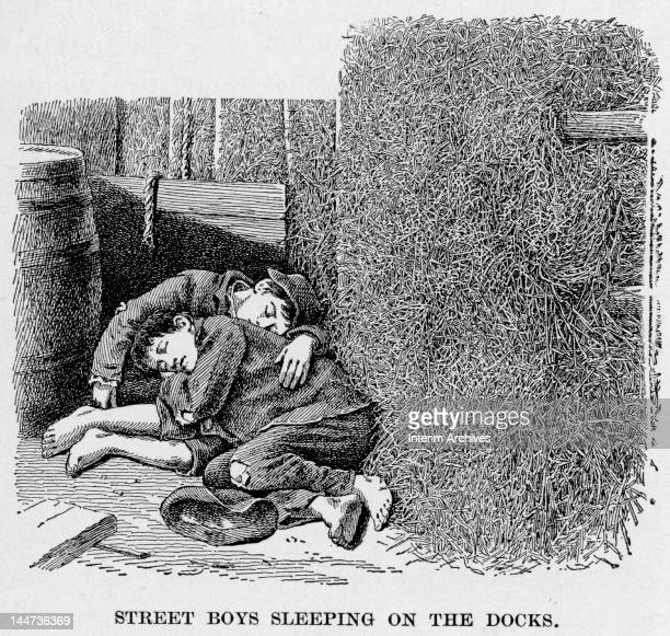 Illustration entitled 'Street Boys Sleeping on the Docks,' shows a pair of barefoot boys huddled together and asleep, late 19th century.