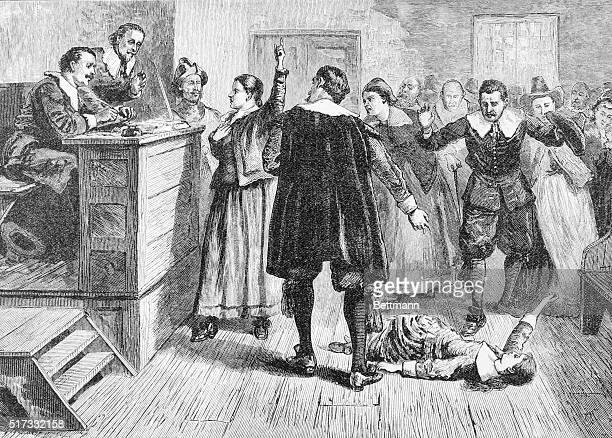 "Illustration entitled ""WITCHCRAFT AT SALEM VILLAGE,"" depicting a girl lying on a courtroom floor. Undated engraving."