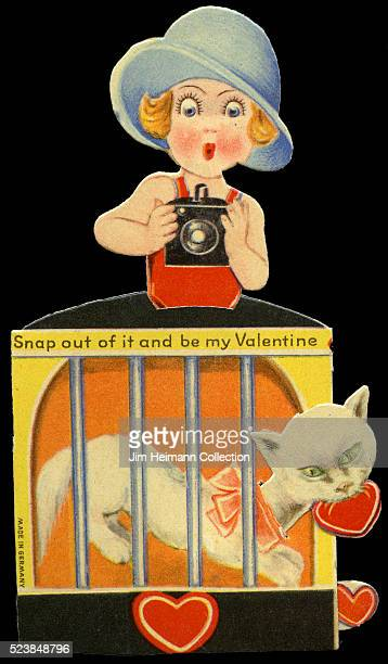 Illustration for a diecut 1932 Valentine's Day card featuring young girl holding camera photographing caged cat