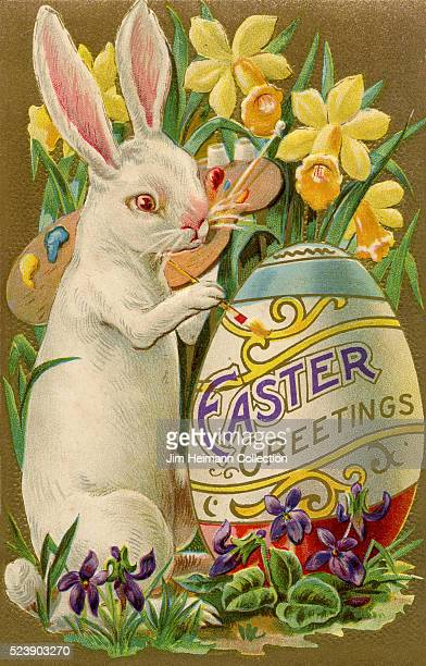 Illustration for Easter postcard featuring standing rabbit painting egg