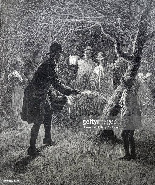 Illustration from a book depicting Wassailing the apple trees an ancient custom of visiting orchards in ciderproducing regions where people would...