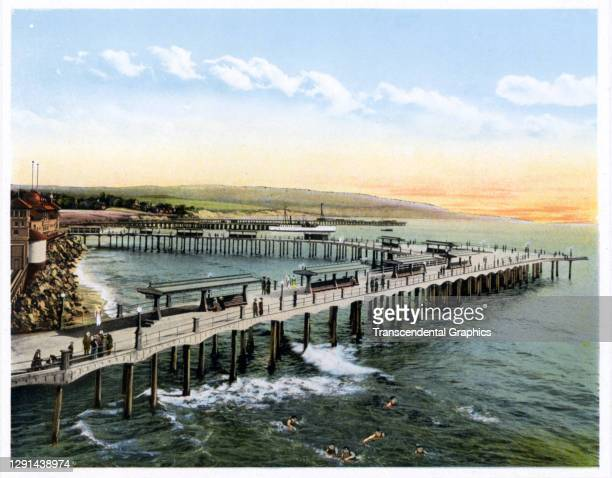 Illustration, from a souvenir album of Southern California scenes, shows a view of a pier over the water in Redondo Beach, California, 1907.