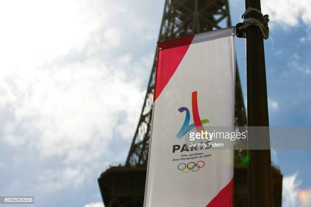 Illustration Logo Olympics Games Paris 2024 and the monument Eiffel Tower during Paris 2024 Olympics Games in street for the city's candidacy for...