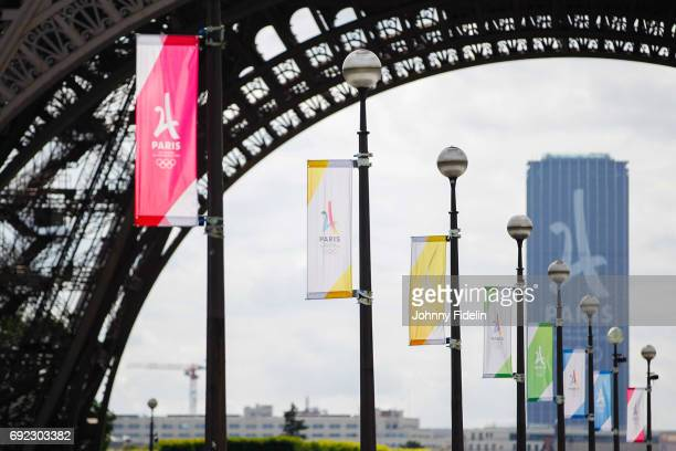 Illustration Logo Olympics Games Paris 2024 and the monument Montparnasse Tower during Paris 2024 Olympics Games in street for the city's candidacy...