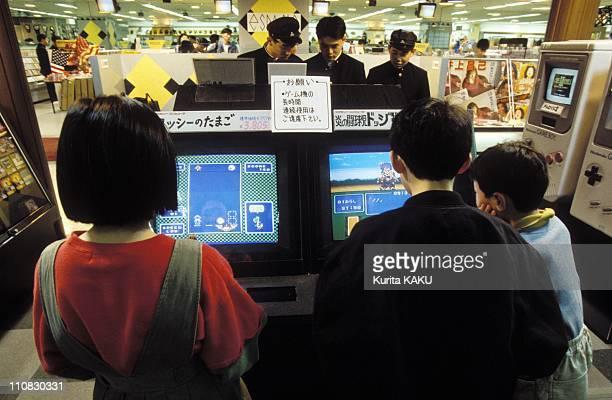 Illustration Nintendo Games In Japan In April 1992 Children playing at Nintendo entertainment corner in Kyoto