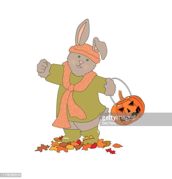 Illustration of a cute rabbit/bunny holding a jack-o-lantern on a white background