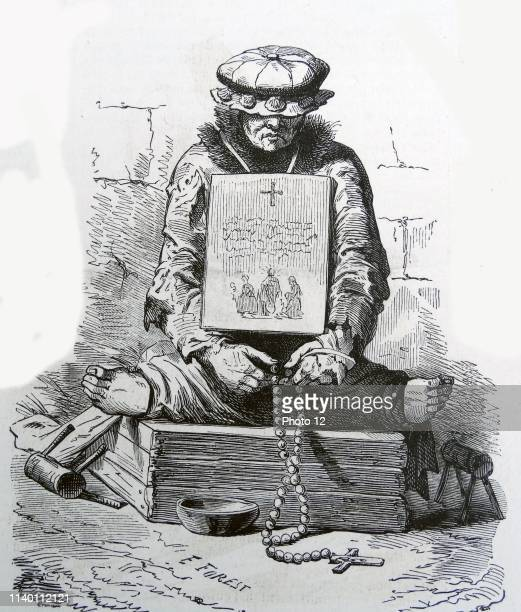 Illustration of a French medieval leper On either side of him are hand crutches which would be used to propel the leper forward He is also sat with...