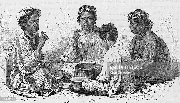 Illustration of a group of Hawaiian women and a young boy sitting and eating poi from a large pot circa 1900