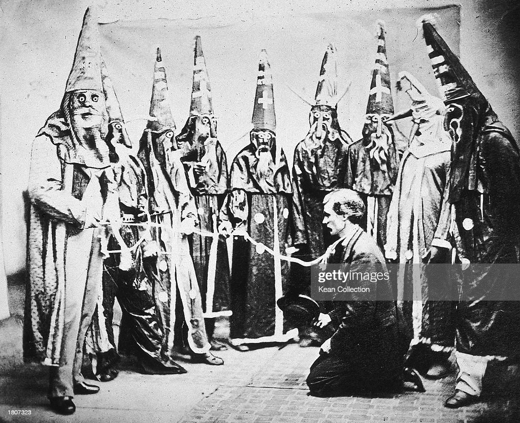 Illustration of a group of hooded Ku Klux Klan members preparing to lynch president Abraham Lincoln, circa 1867.