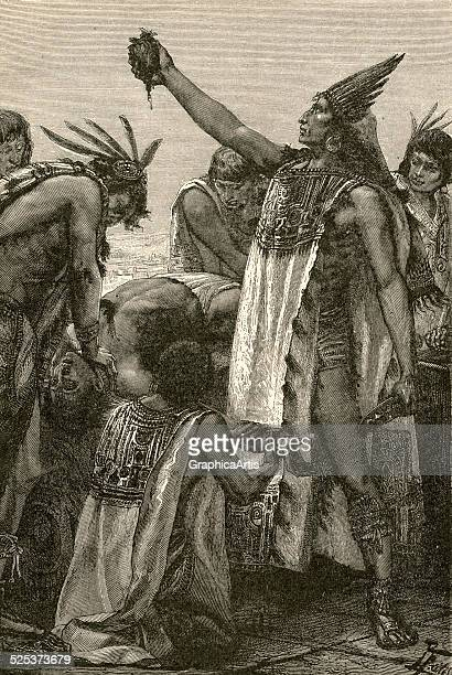 Illustration of an Aztec priest holding the heart of a human sacrifice victim engraving 1892