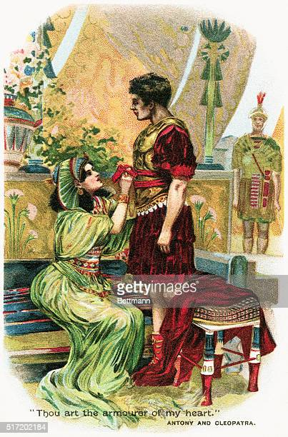 Illustration of Antony and Cleopatra She is seated tugging on his sash Underneath is the quotation 'Thou art the armourer of my heart' Undated