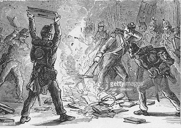 Illustration of British soldiers burning books in piles within the US Library of Congress Washington DC circa 1814