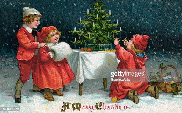 Illustration of children decorating a Christmas tree outside in the snow 1912 Chromolithograph