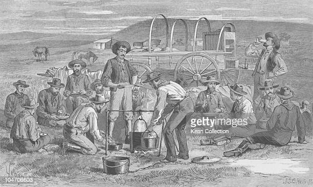 Illustration of cowboys sitting round a camp fire circa 1850