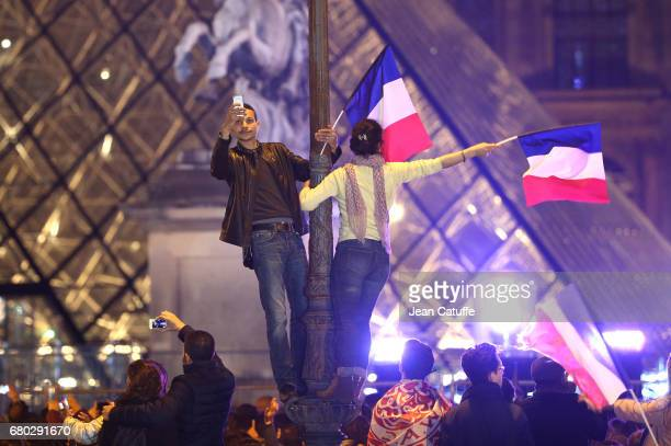 Illustration of supporters of Emmanuel Macron during the celebration of newly French President elected Emmanuel Macron at Le Louvre plaza on May 7...