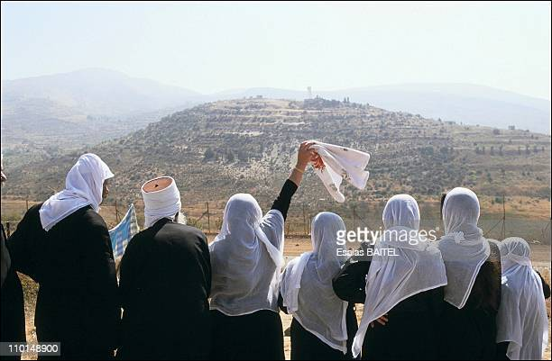 Illustration of The Golan in Israel in August, 1991 - Members of the Druze community speaking to their relatives in Syria